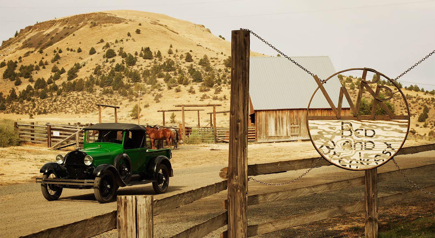 Wilson Ranches Retreat sign and old ford truck