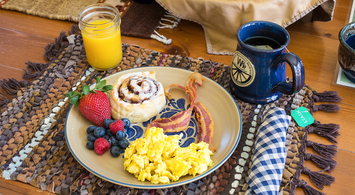 Breakfast with cinnamon bun eggs and bacon