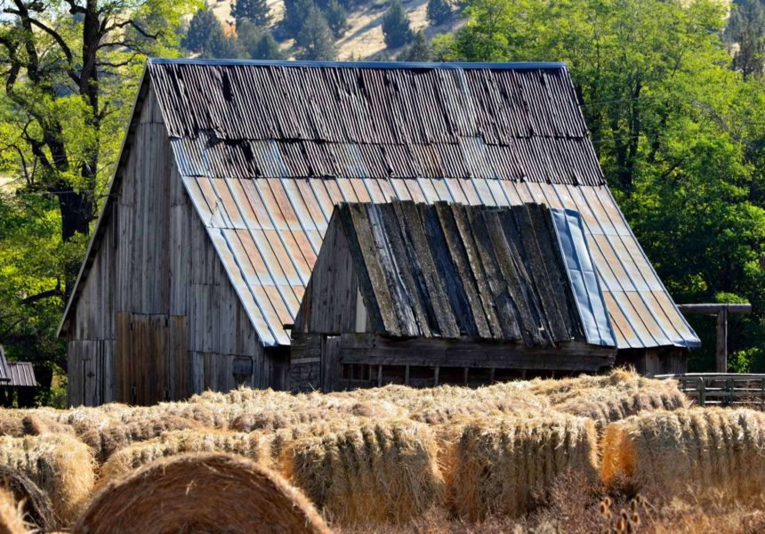 A barn with bales of hay