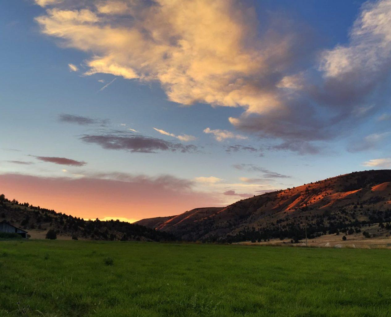 A scenic vista of the setting sun