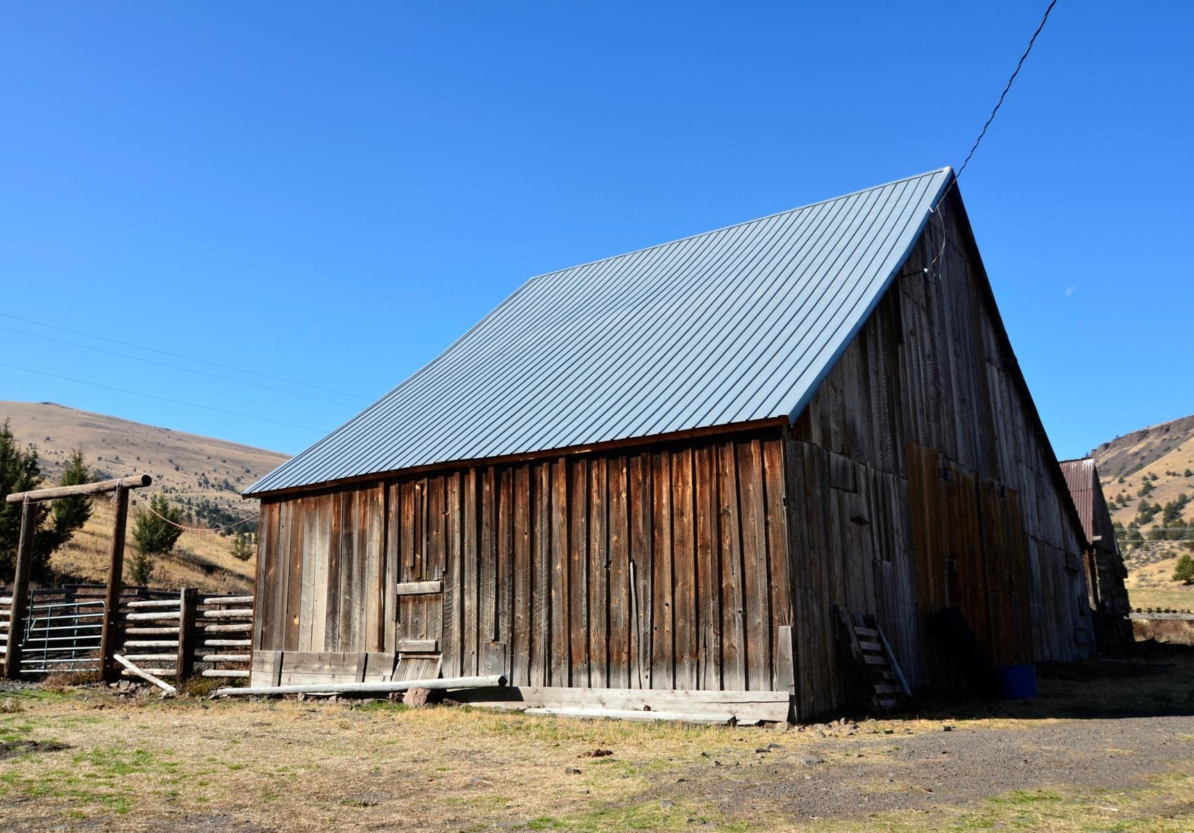 Wooden barn site of the travel trailer