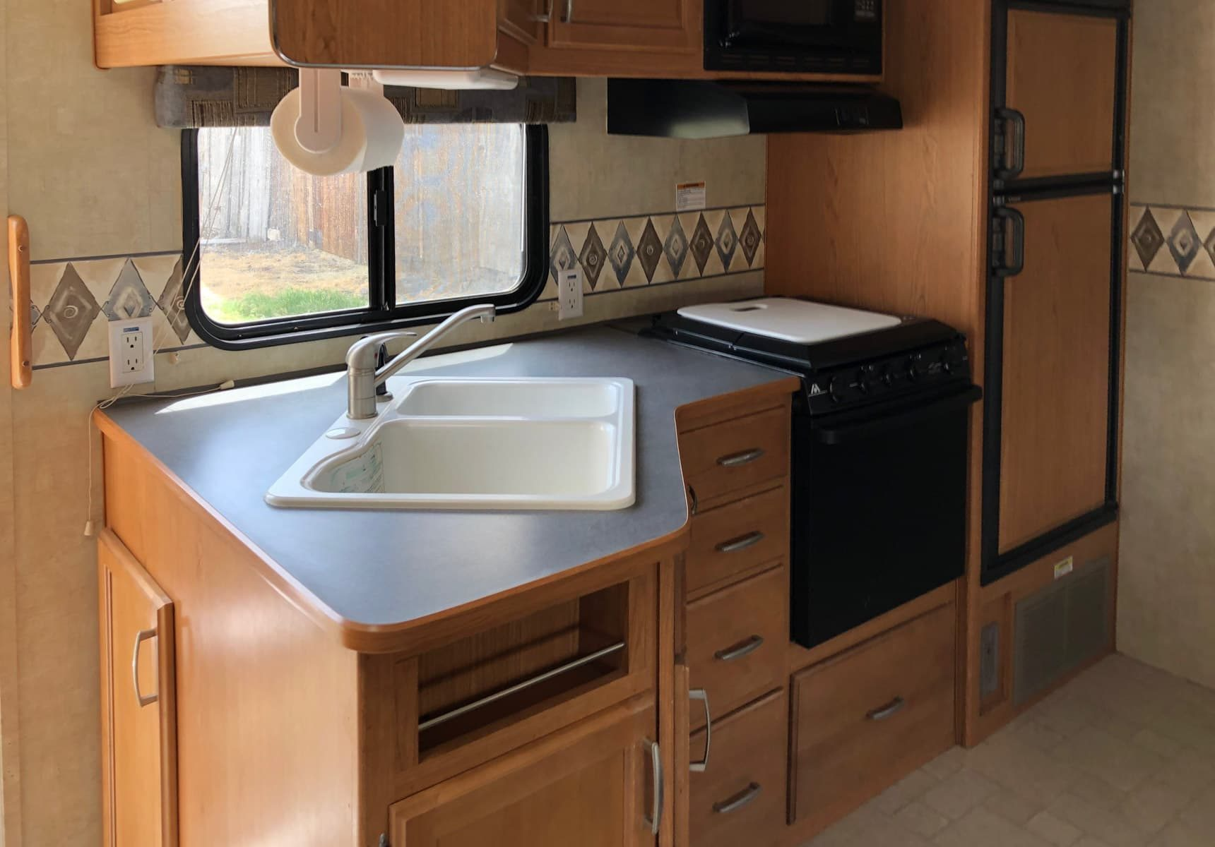 Travel trailer kitchen sink and counter